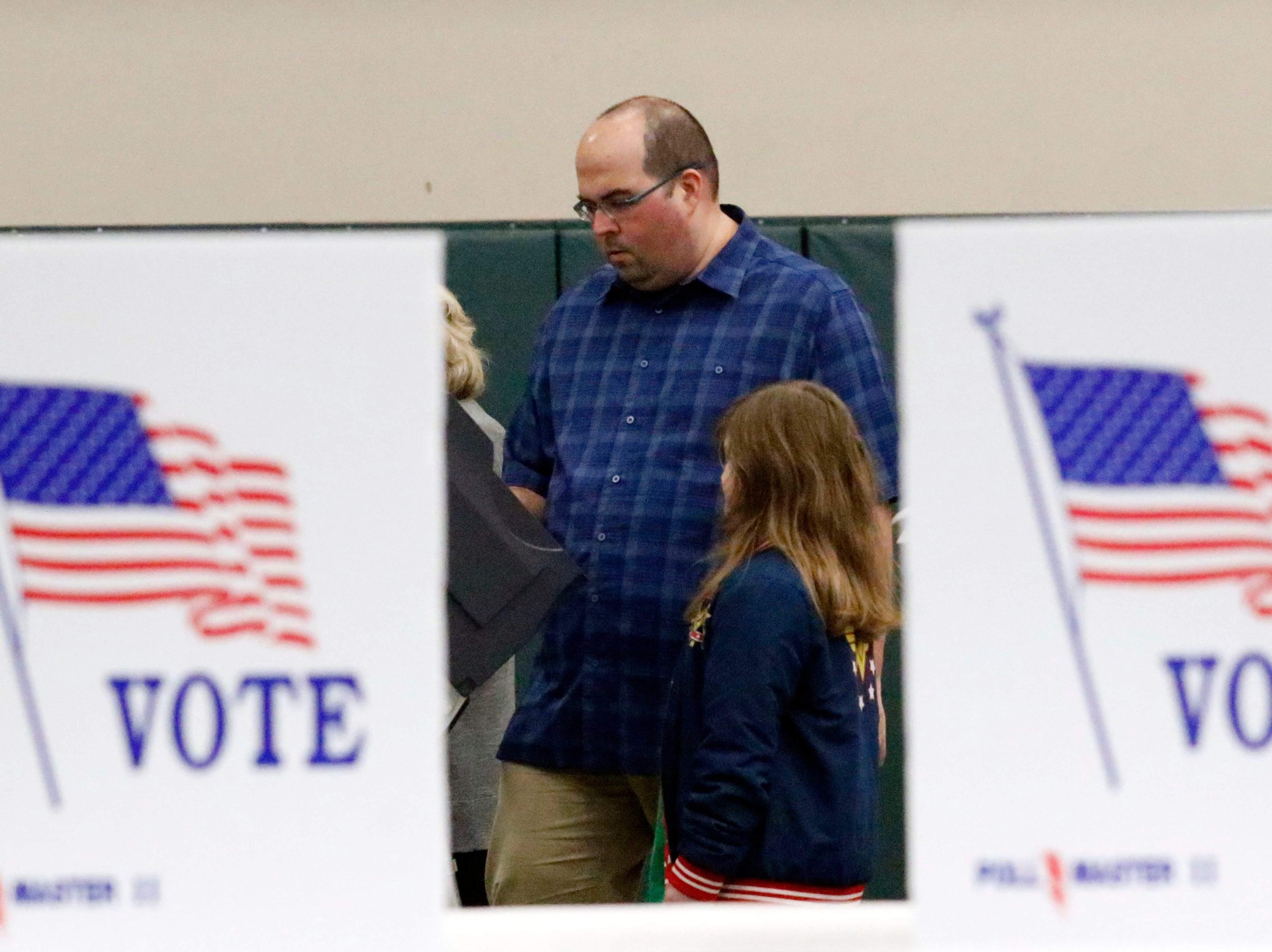 Jared Bailey, from Lancaster, votes with his daughter Chloe Bailey Tuesday, Nov. 6, 2018, at the Crossroads Ministry Center in Lancaster. Voting for multiple Lancaster precincts takes place at the center.