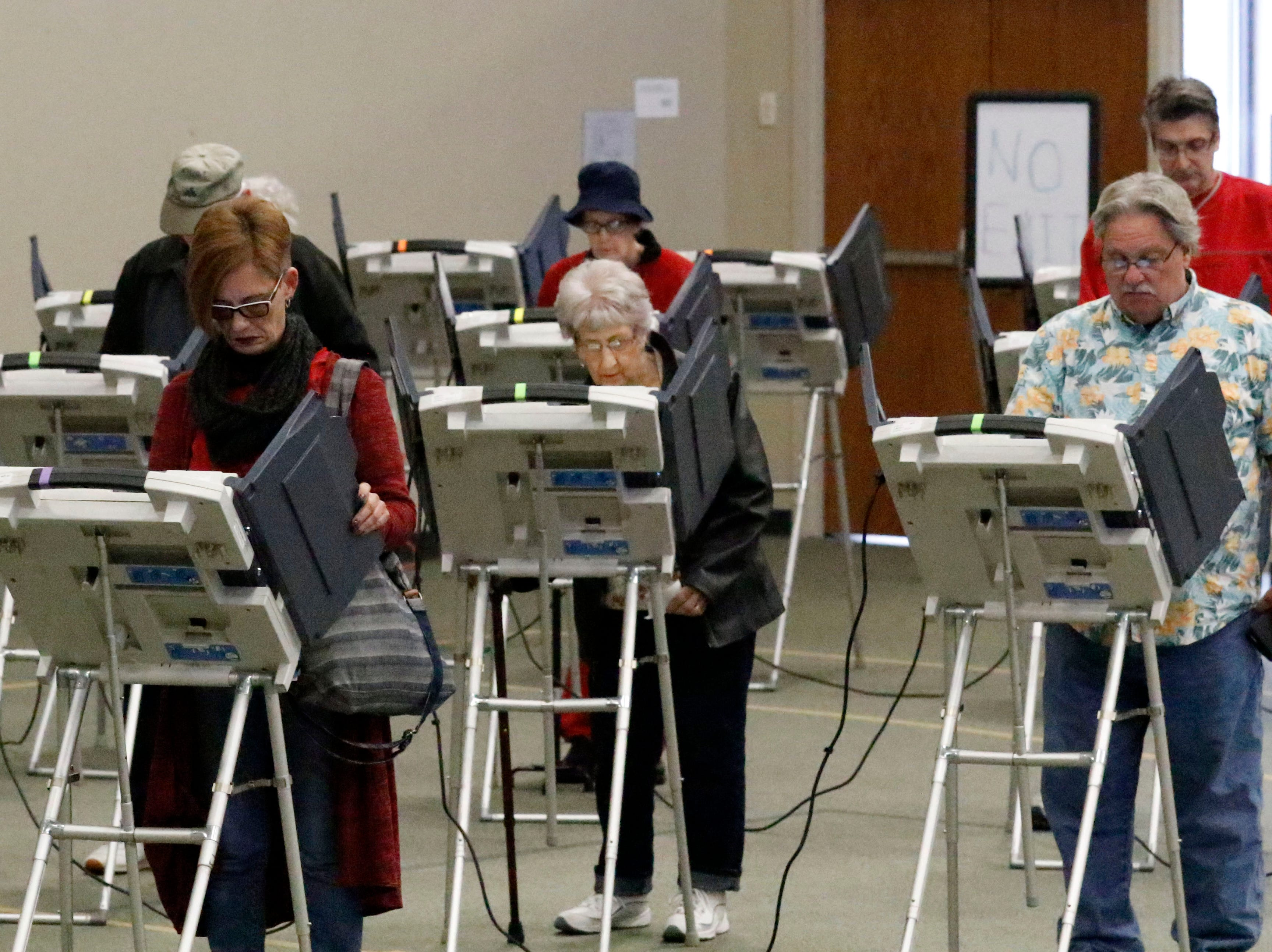 Voters cast their ballots Tuesday, Nov. 6, 2018, at the Crossroads Ministry Center in Lancaster.