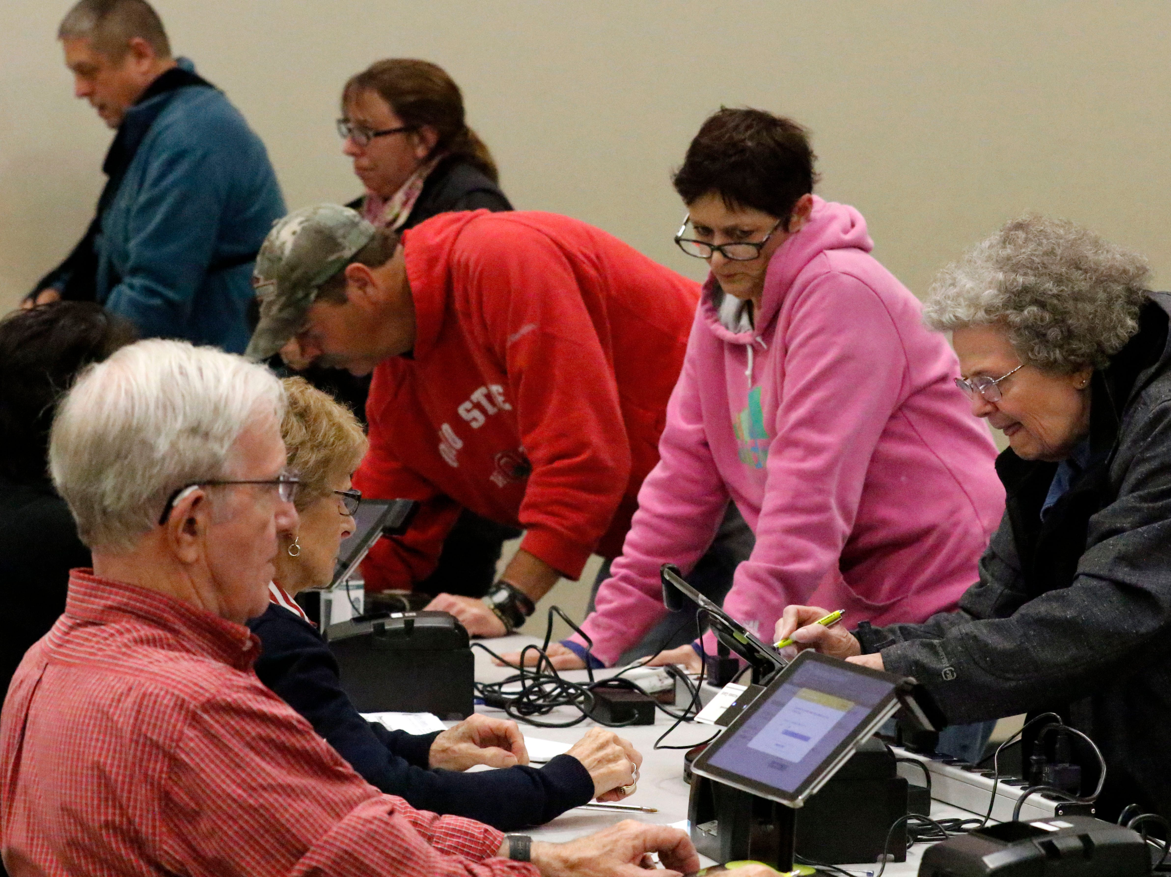 Voters sign in to cast their ballots Tuesday, Nov. 6, 2018, at the Crossroads Ministry Center in Lancaster.