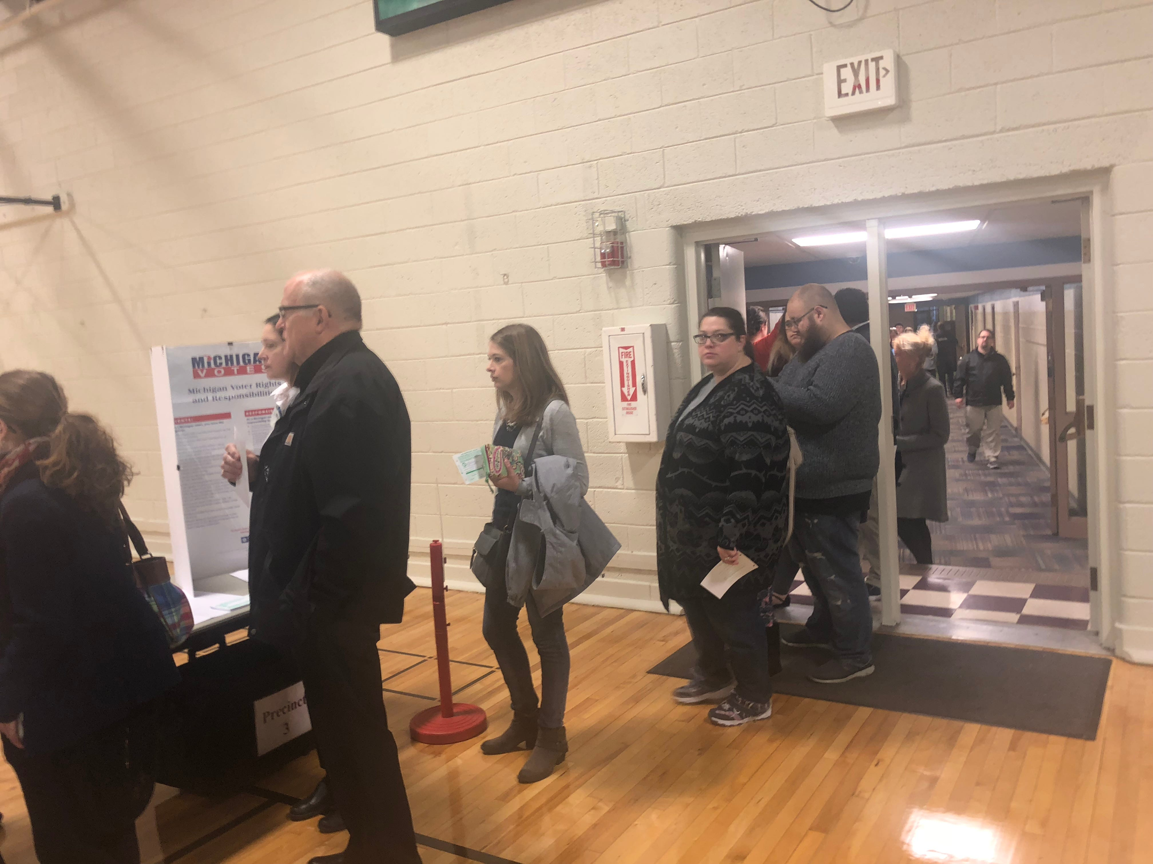 Voters wait in line at the Brighton Educational Community Center on Tuesday morning, Nov. 6, 2018.