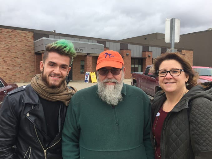 The LaFond family of Hamburg Township, from left son David, father Don and mother Mary, voted together at Pinckney Community School's campus, Tuesday, Nov. 6, 2018.