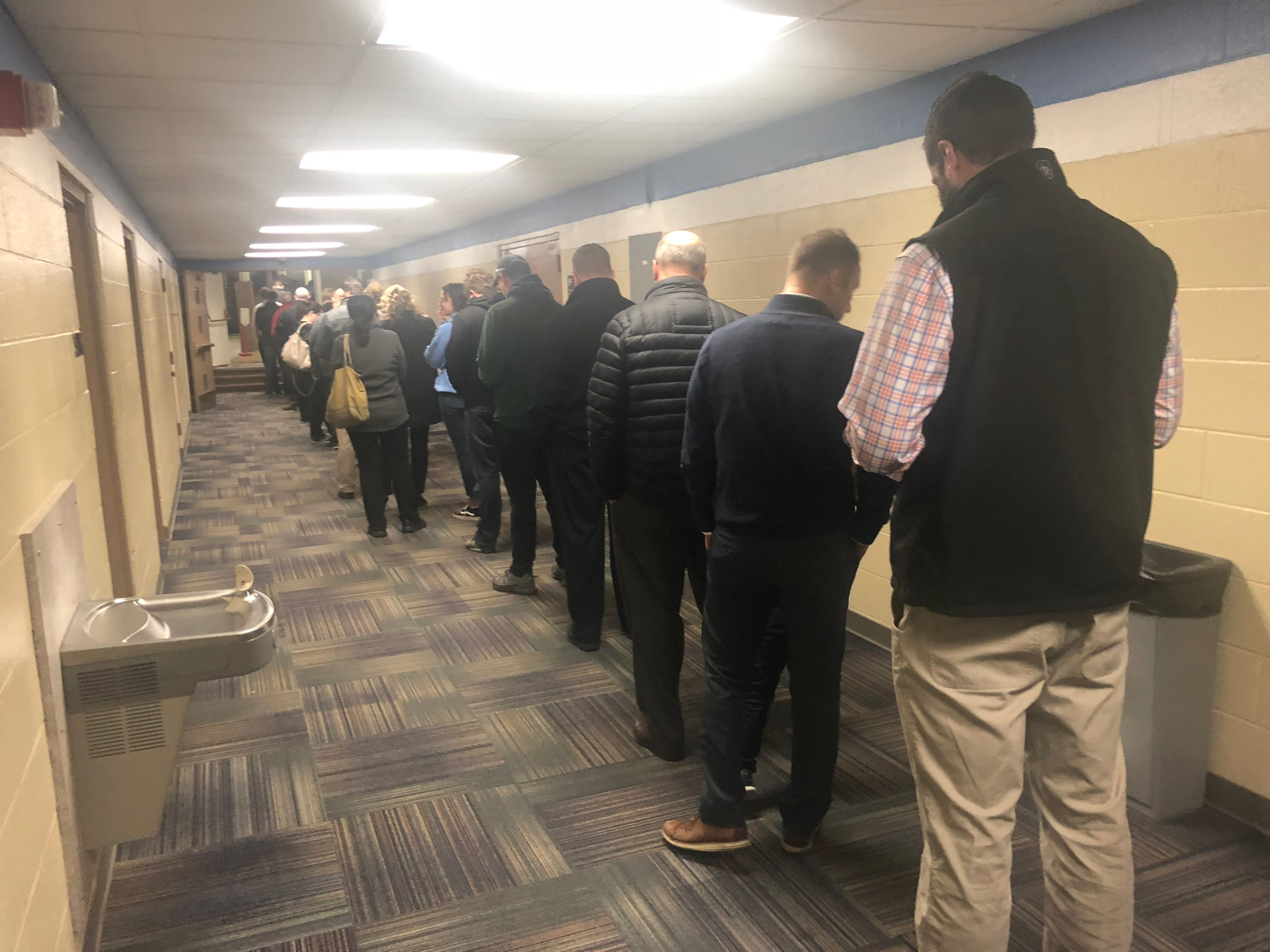 Voters line up to cast their ballots in precinct 3 at the Brighton Educational Community Center building on Tuesday morning, Nov. 6, 2018.
