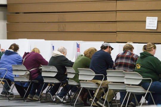 Voters in Hartland's precinct 3 cast their ballots in the Hartland Educational Support Service Center, housing five precinct polls, Tuesday, Nov. 6, 2018.