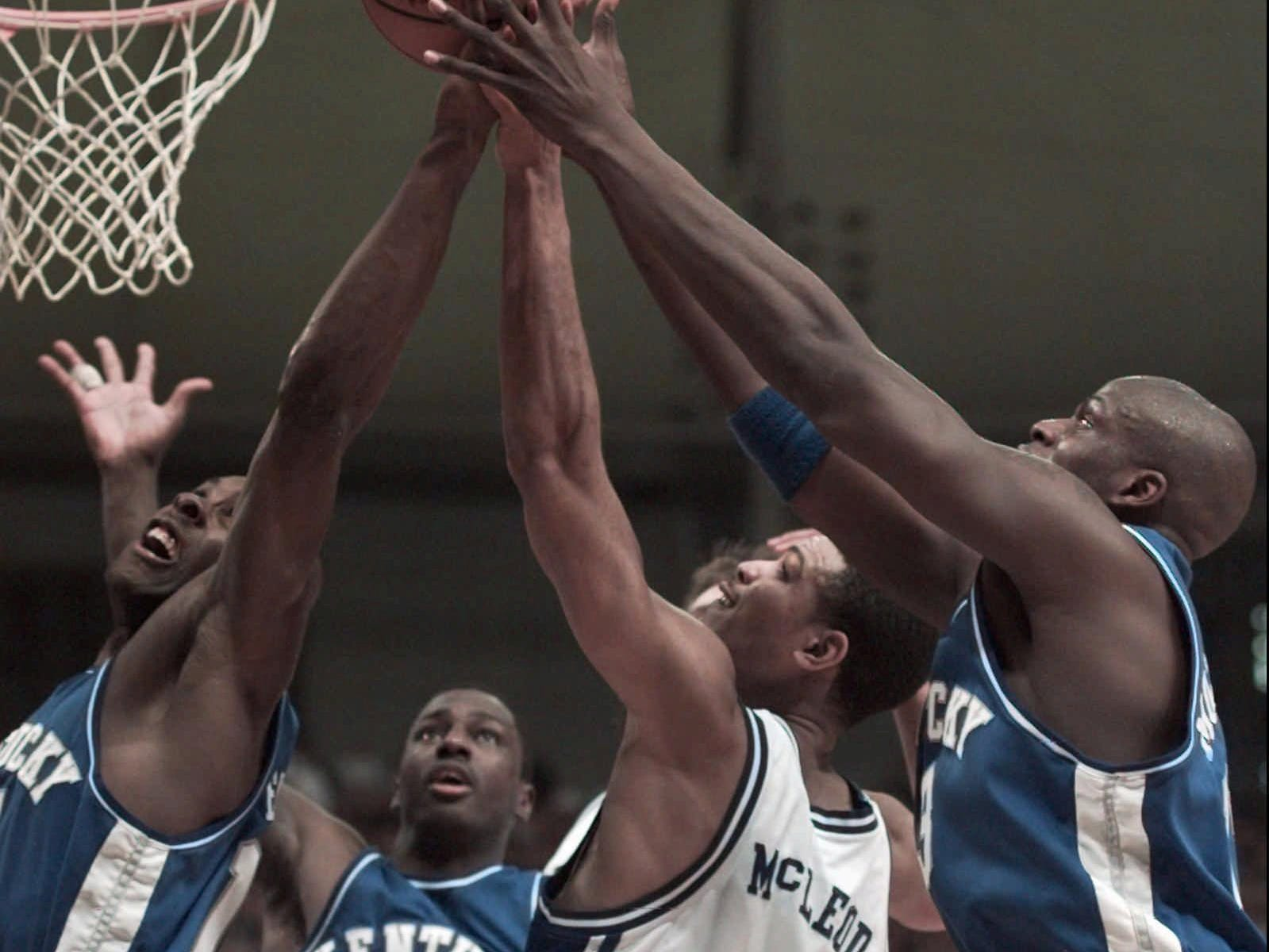 Duke's Roshown McLeod was surrounded by Wildcats in the regional final. UK beat Duke on the boards, 45-39, and on the scoreboard, 86-84.-