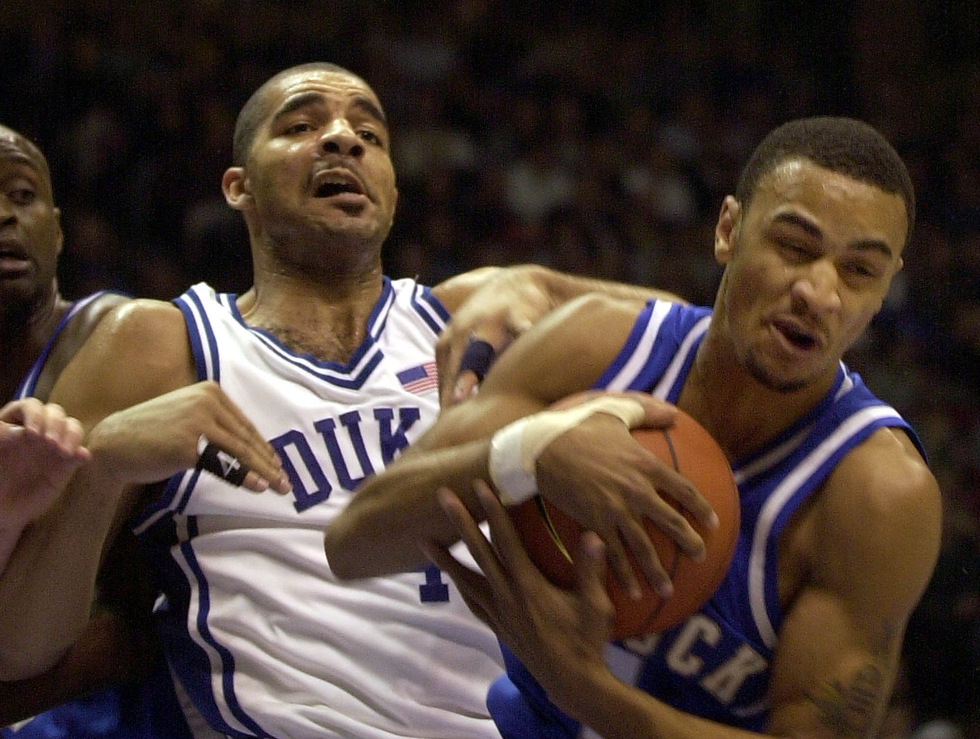 Duke's Carlos Boozer, left, defends Kentucky's Gerald Fitch during the first half of the Jimmy V classic in East Rutherford, N.J. Tuesday Dec., 18, 2001.