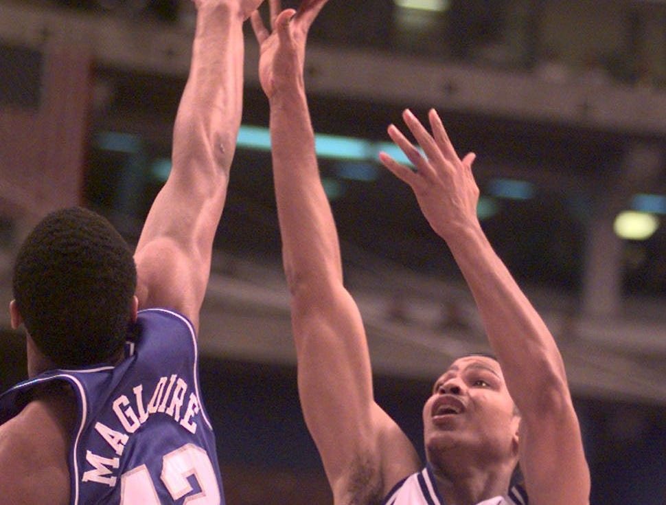 UK's Jamaal Magloire blocks the shot of Duke's Roshown McCleod in the 2nd half.