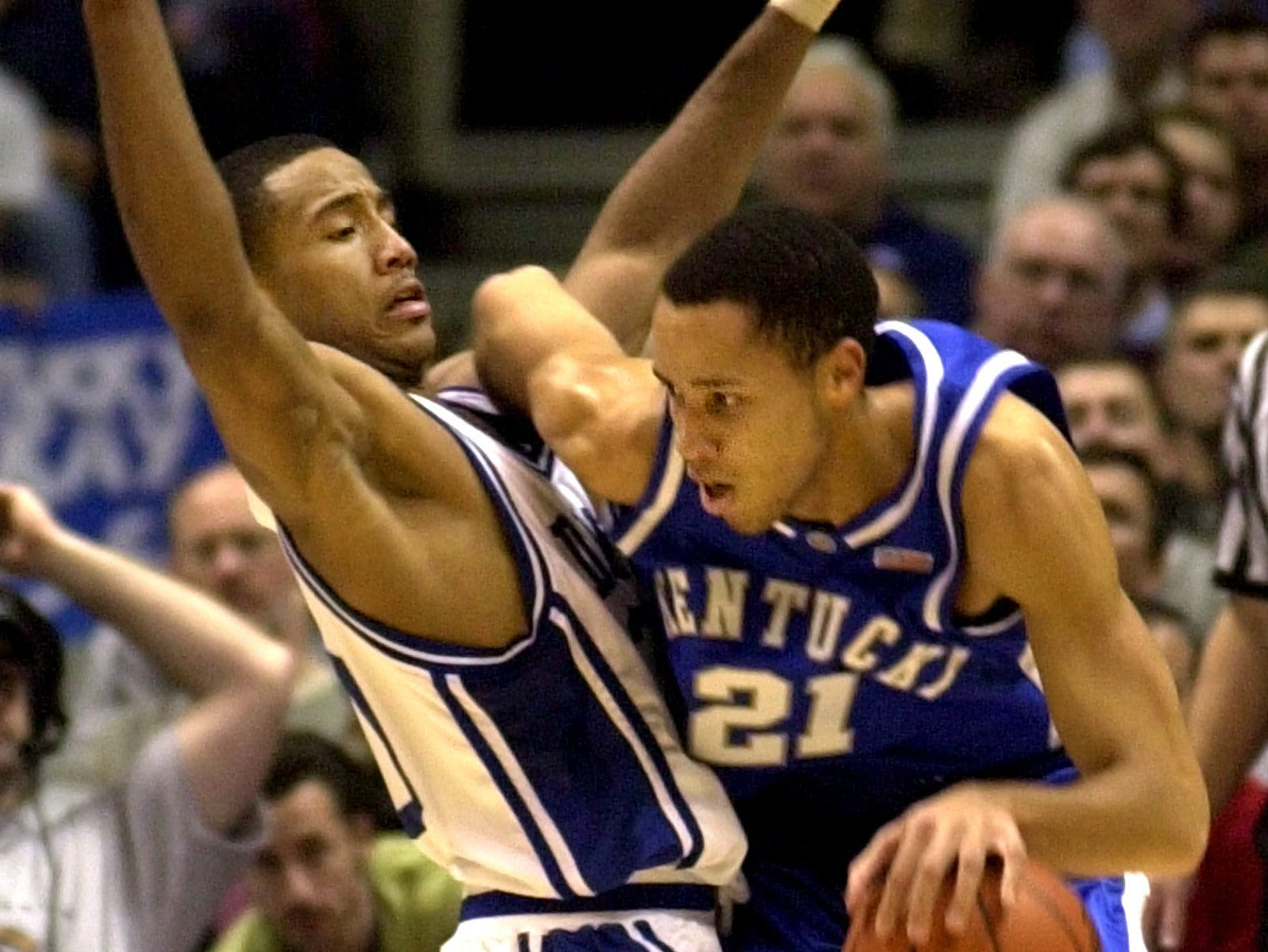 Kentucky's Tayshaun Prince, right, runs into the defense of Duke's Dahntay Jones during the first half of the Jimmy V Classic Tuesday night, Dec. 18, 2001, in East Rutherford, N.J.