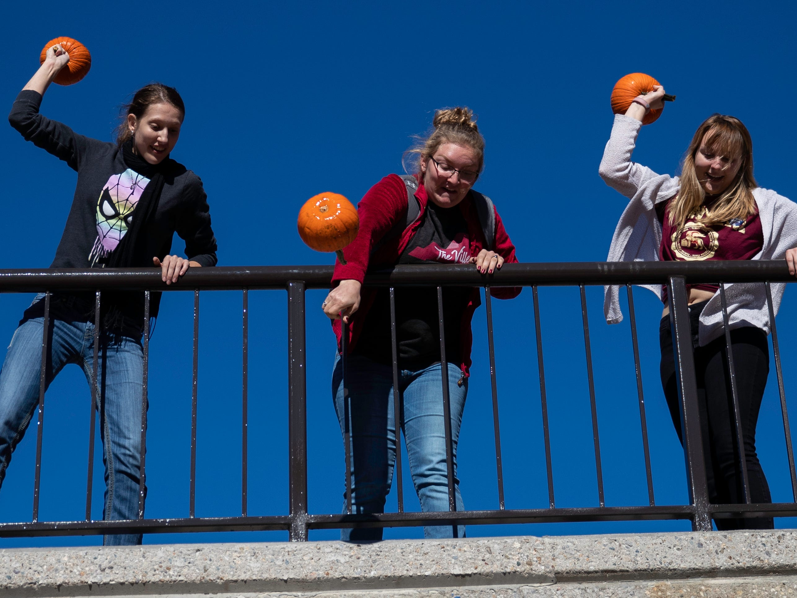 Students and staff members hurled pumpkins off the SAC Ramp, Tuesday, Nov. 6, 2018 in Louisville Ky. The annual Pumpkin Smash in collaboration with the Office of Health Promotion, benefits UofL's Community Composting Project with all smashed pumpkins going into the compost to feed various community gardens, on and off UofL's campus.