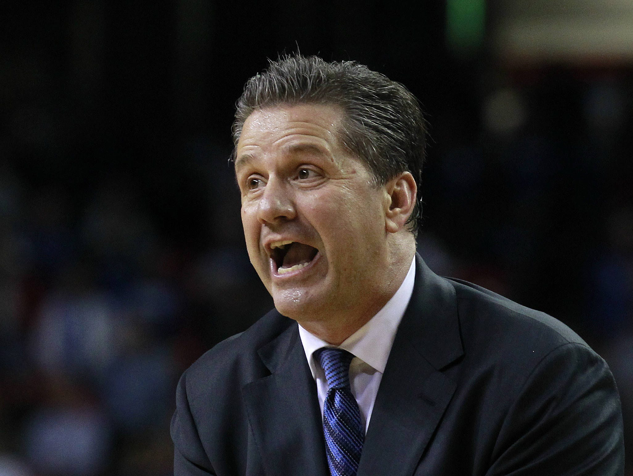 Kentucky head coach John Calipari reacts in the first half of an NCAA college basketball game against  Duke  in Atlanta, Tuesday, Nov. 13, 2012.