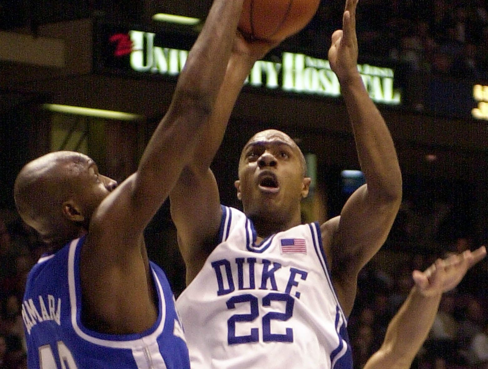Kentucky's Andy Borman defends Duke's Jason Williams during the second half of the Jimmy V classic in East Rutherford, N.J. Tuesday Dec., 18, 2001. Duke defeated Kentucky 95-92 in ovetime. Williams scored 38 points