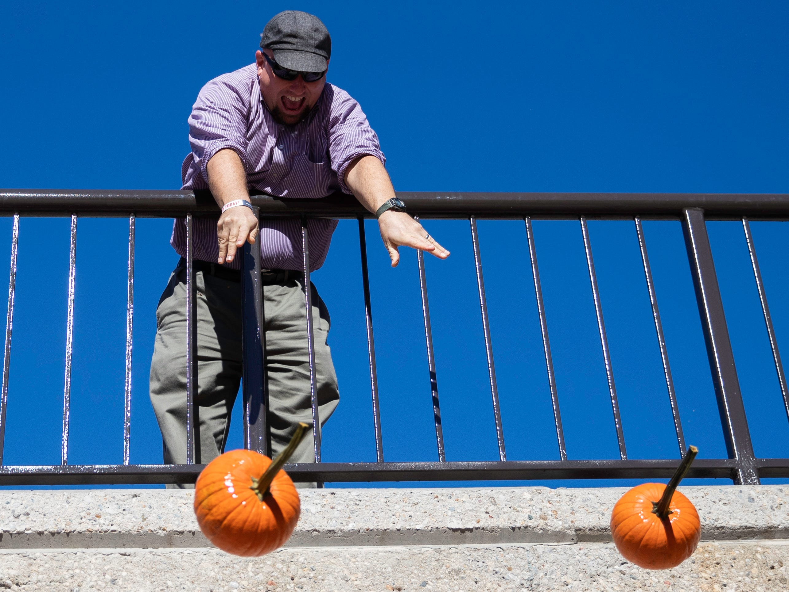Justin Mog hurled pumpkins off the SAC Ramp, Tuesday, Nov. 6, 2018 in Louisville Ky. The annual Pumpkin Smash in collaboration with the Office of Health Promotion, benefits UofL's Community Composting Project with all smashed pumpkins going into the compost to feed various community gardens, on and off UofL's campus.