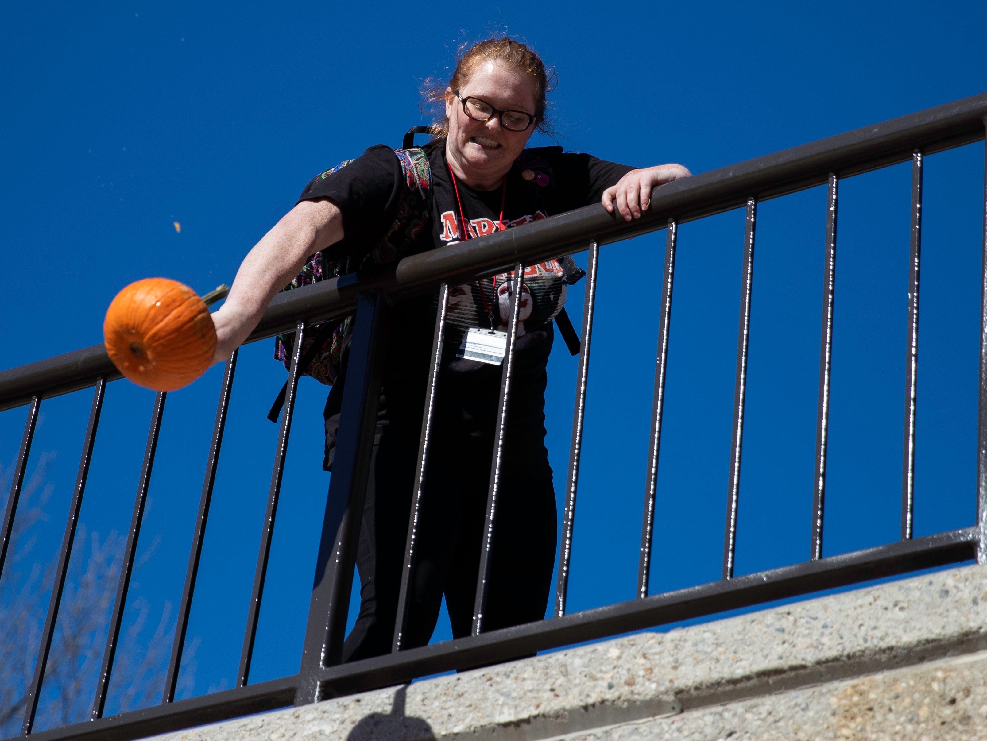 Students and staff members hurled pumpkins off the SAC Ramp, Tuesday, Nov. 6, 2018 in Louisville Ky. The annual Pumpkin Smash in collaboration with the Office of Health Promotion, benefits UofLÕs Community Composting Project with all smashed pumpkins going into the compost to feed various community gardens, on and off UofL's campus.