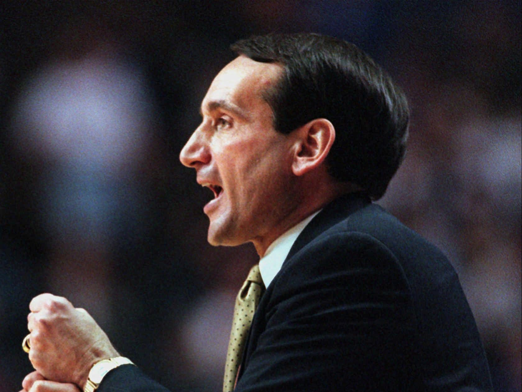 Duke coach Mike Krzyzewski gives signals to his players during their second round game of the NCAA South Regional Sunday, March 15, 1998 in Lexington, Ky. Duke defeated Oklahoma State 79-73.