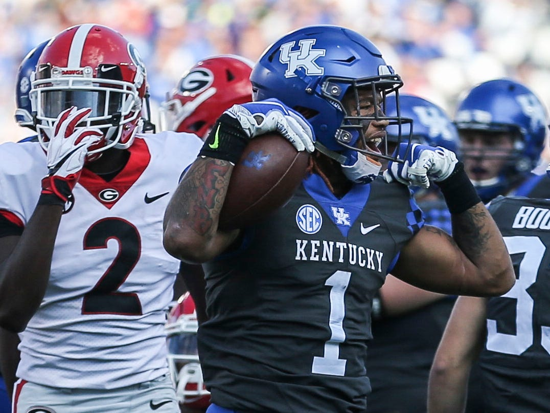 Kentucky's Lynn Bowden, Jr. flexes during the game against Georgia Nov. 3, 2018. The Cats would lose to the Bulldogs.