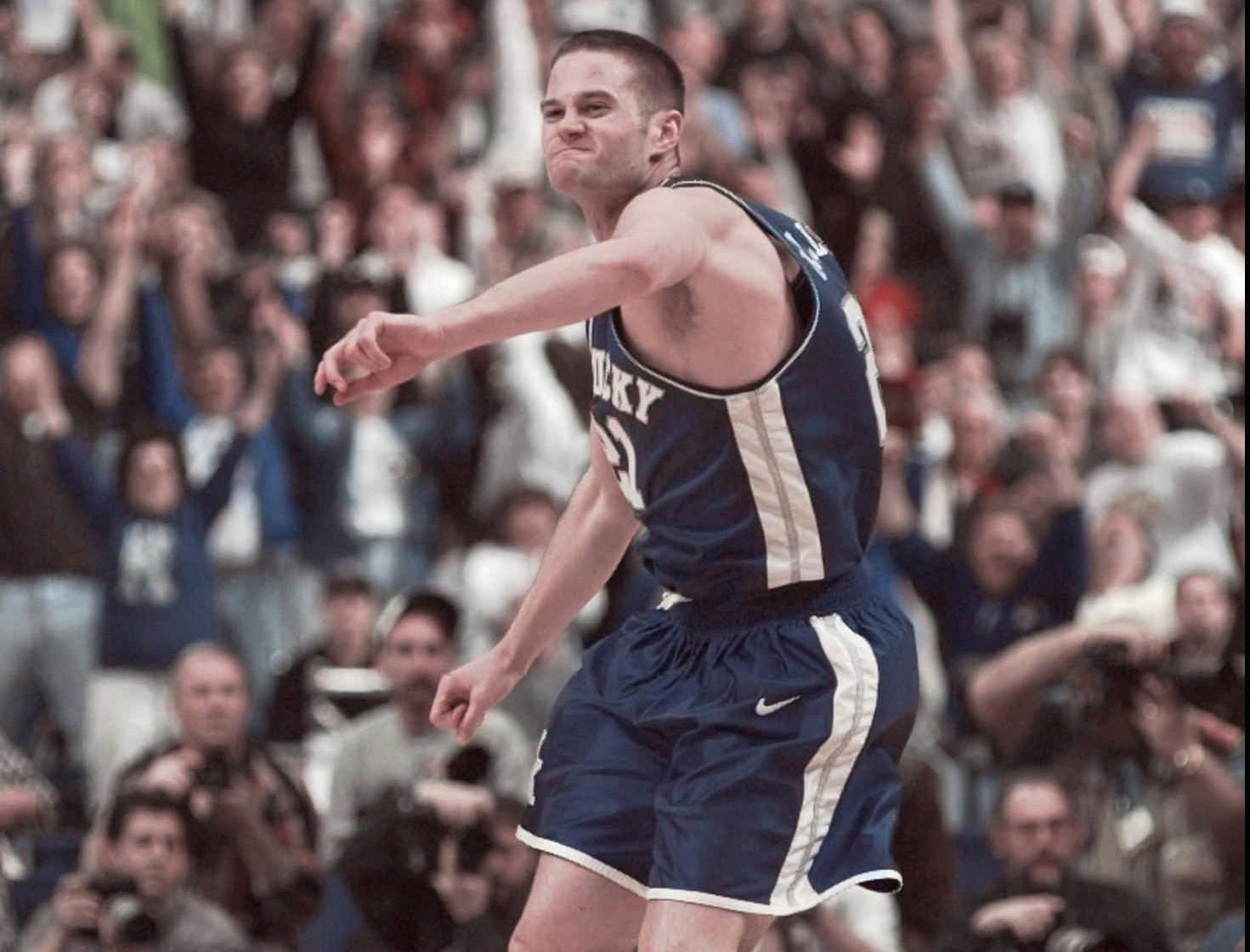 Kentucky's Cameron Mills celebrates after sinking a three pointer to tie the score during the 2nd half of the NCAA South Regional Final against Duke in St. Petersburg, Fla., Sunday, March, 22, 1998.