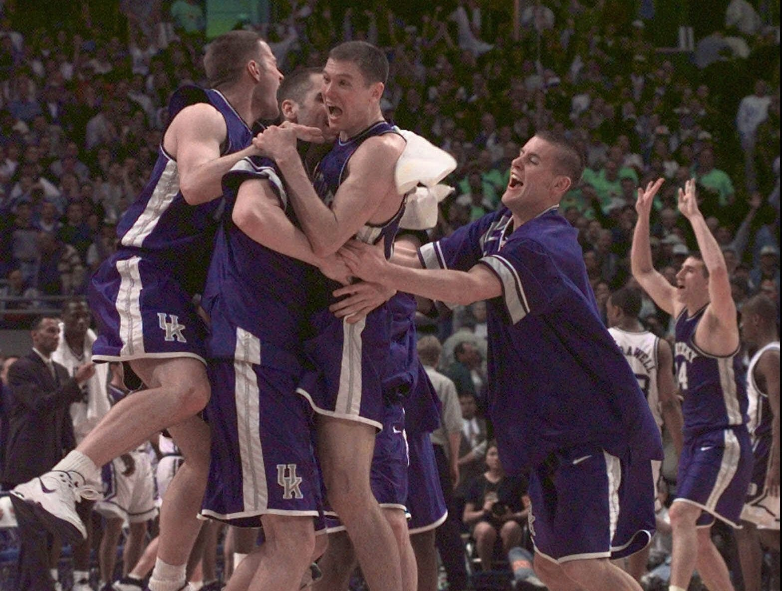 University of Kentucky players celebrate after they won the NCAA Southern Regional Finals in St. Petersburg, Fla., with a score of 86-84 Sunday, March 22, 1998.