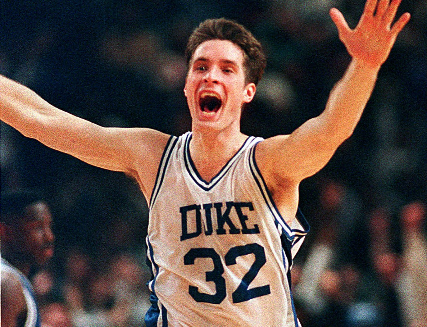 Duke's Christian Laettner runs down the court after making the last-second winning shot to defeat Kentucky 104-103 in overtime in the East Regional Final NCAA college basketball game in Philadelphia.