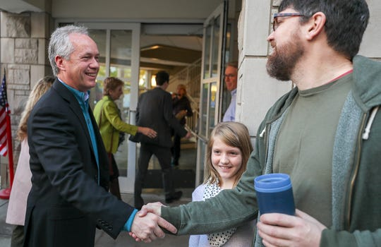 Mayor Greg Fischer greets voters as he enters his polling location at St. Paul United Methodist Church in the Highlands.