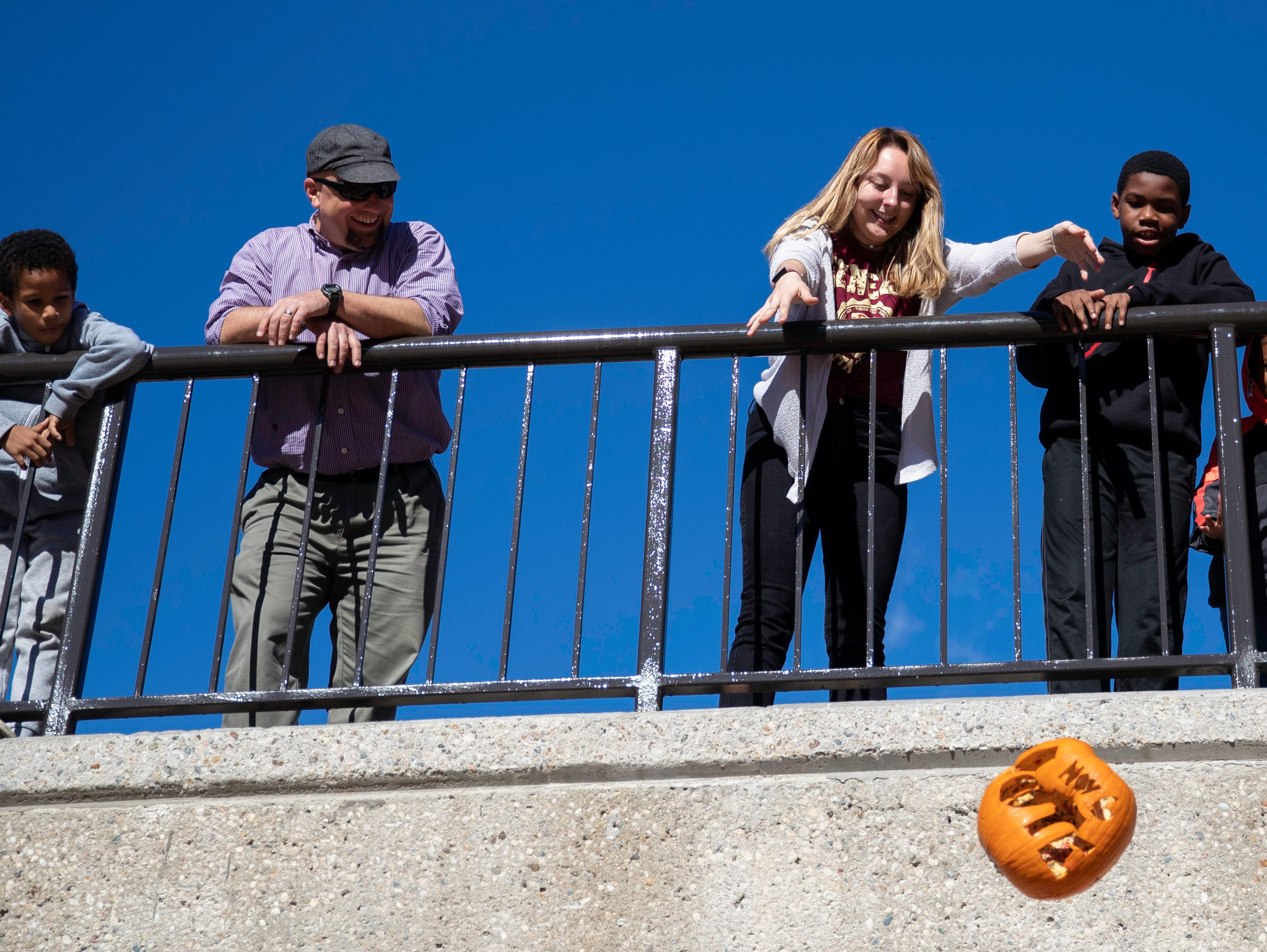 """Emory Jones threw the final """"Vote Nov 6"""" pumpkin off the SAC Ramp to conclude the pumpkin smashing event, Tuesday, Nov. 6, 2018 in Louisville Ky. The annual Pumpkin Smash in collaboration with the Office of Health Promotion, benefits UofL's Community Composting Project with all smashed pumpkins going into the compost to feed various community gardens, on and off UofL's campus."""