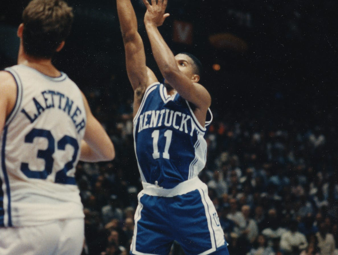 Christian Laettner watches as UK's Sean Woods puts up the last Kentucky basket that put UK ahead 103 to 102 in the last seconds, but Duke was left with enough time for Laettner to make the game winning shot and end UK's hopes of a final four bid. 