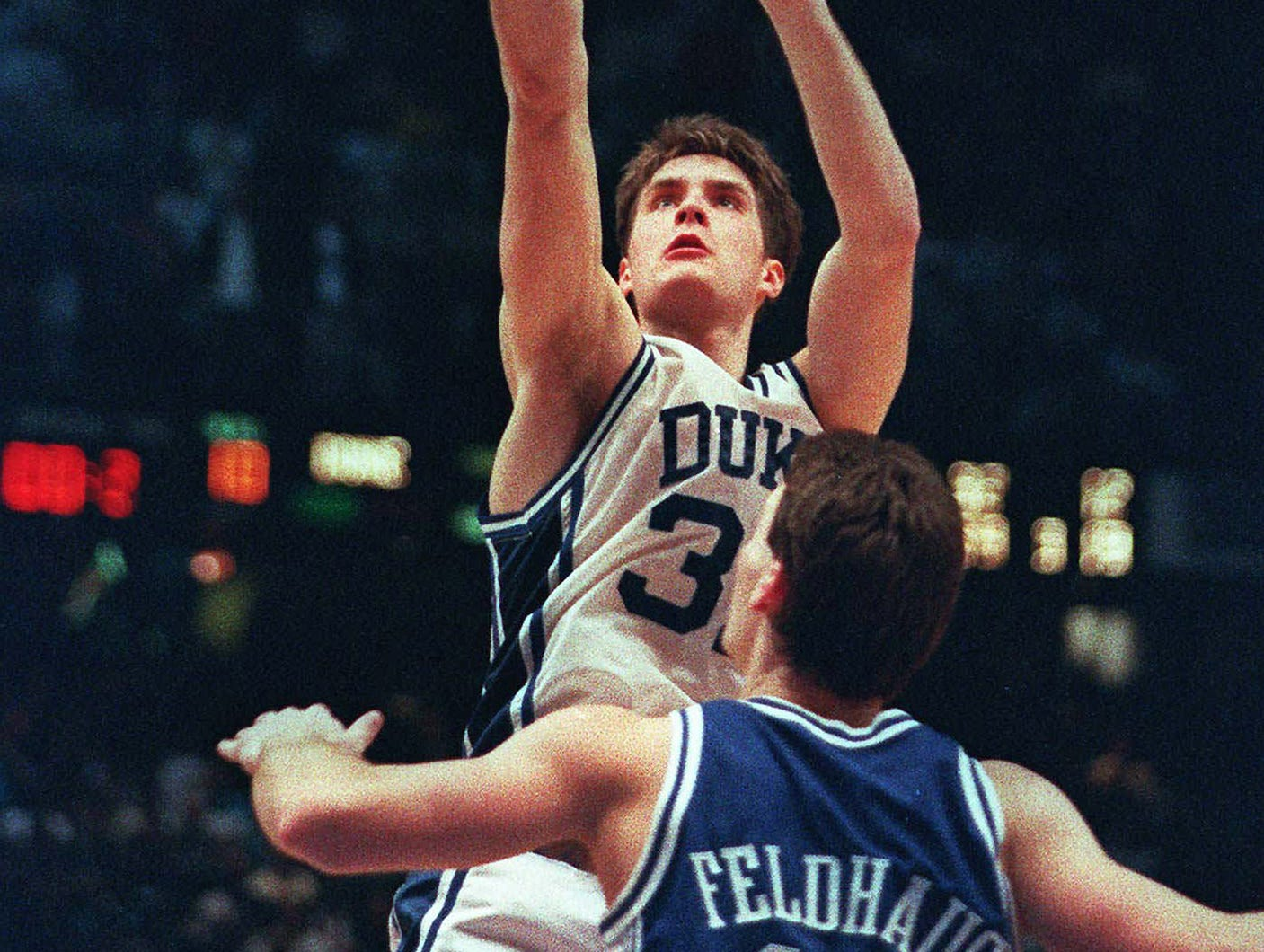 Duke's Christian Laettner shoots the game-winning basket in overtime over Kentucky's Deron Feldhaus to win the East Finals NCAA college basketball game, in Philadelphia. Duke beat Kentucky 104-103.