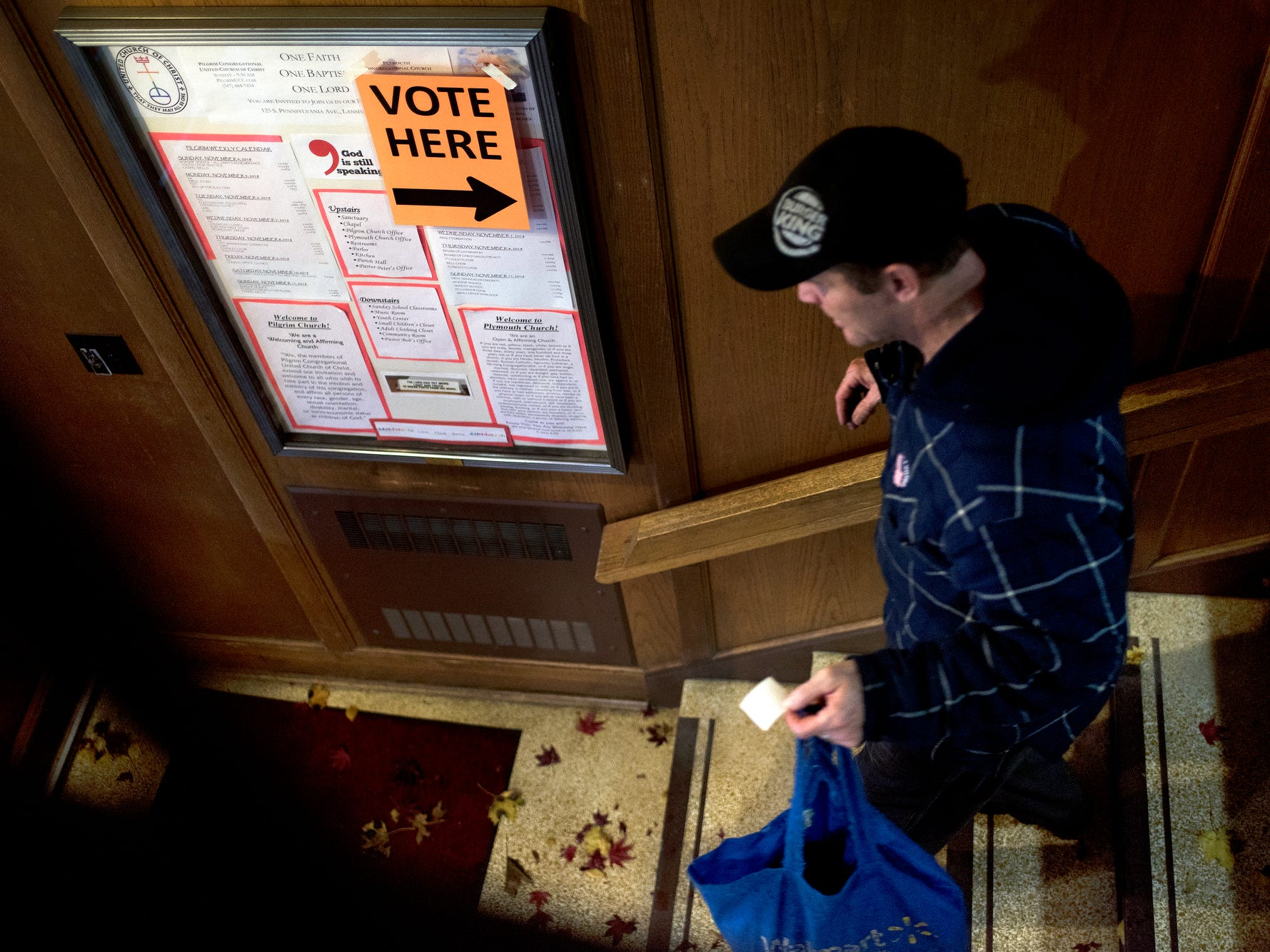 A voter leaves the polling place after casting a ballot on Tuesday, Nov. 6, 2018, at Pilgrim Congregational United Church of Christ in Lansing.