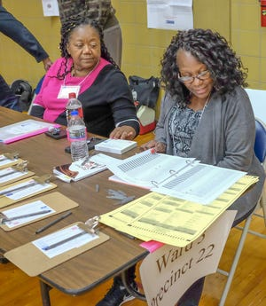 Election Inspectors Pat Smith, left, and Donica Cash are at work in Ward 3, Precinct 22 Tuesday, Nov. 6, 2018.