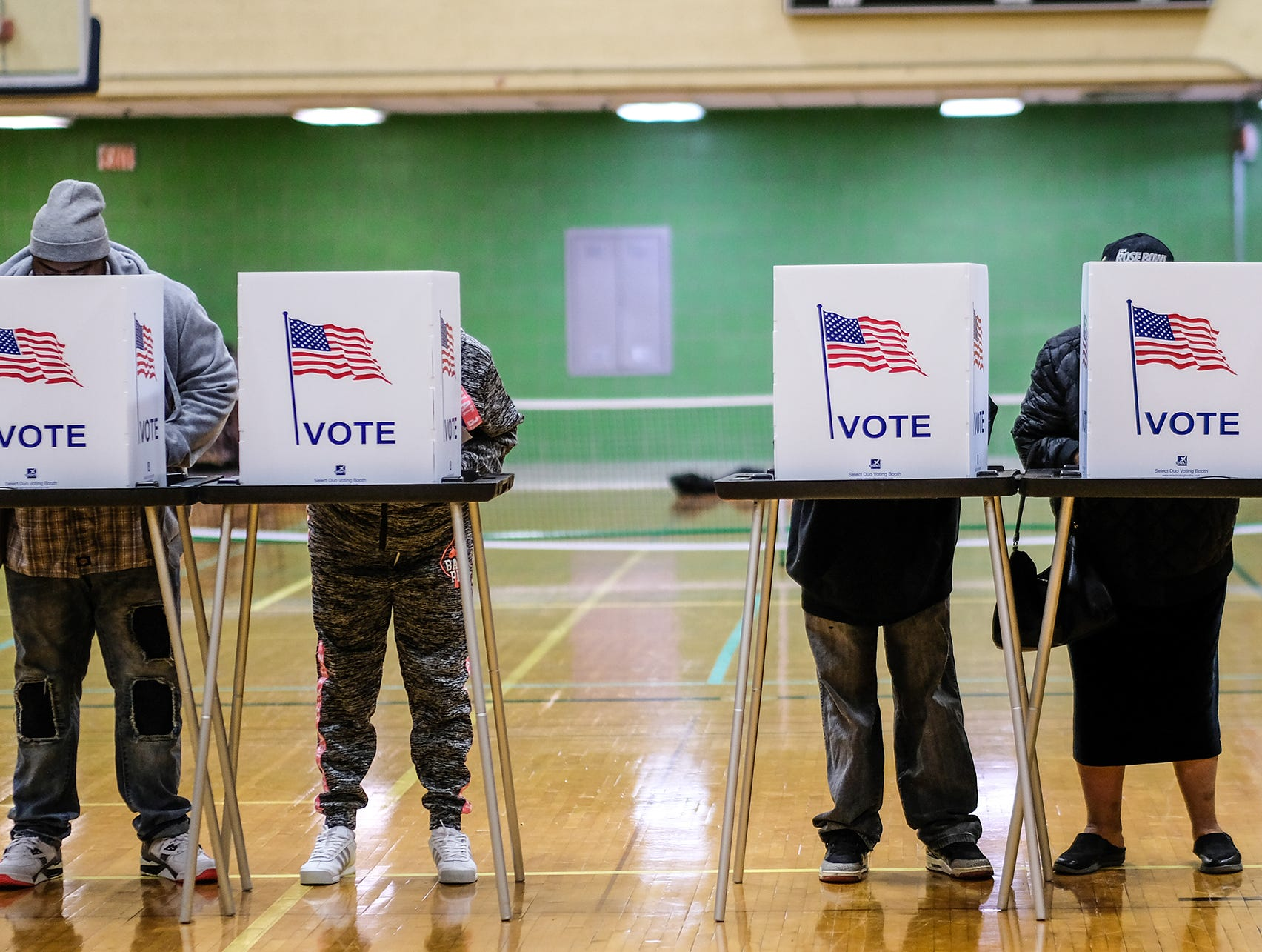 Voters fill the voting booths at Alfreda Schmidt South Side Community Center in Lansing as they cast their votes Tuesday, Nov. 6, 2018.