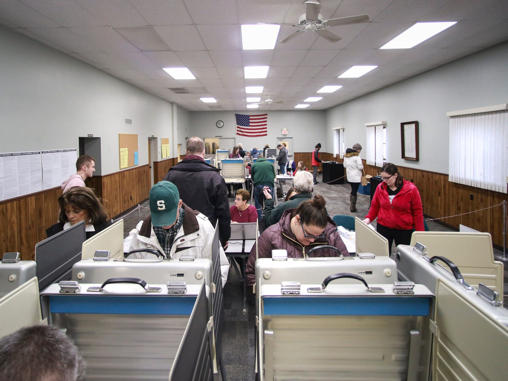 People cast their midterm votes at the Alaiedon Township Hall in Mason, Tuesday afternoon, Nov. 6, 2018, for the 2018 midterm elections.