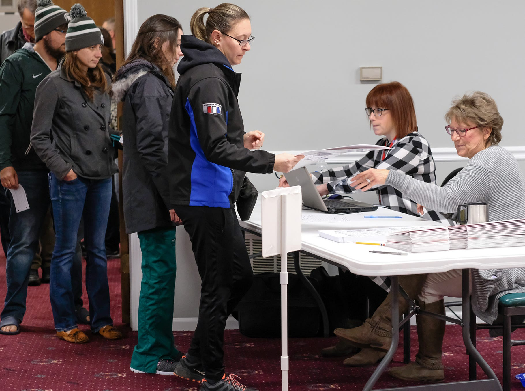St. Johns voters get their ballots at Bingham Township Hall Tuesday, Nov. 6, 2018.