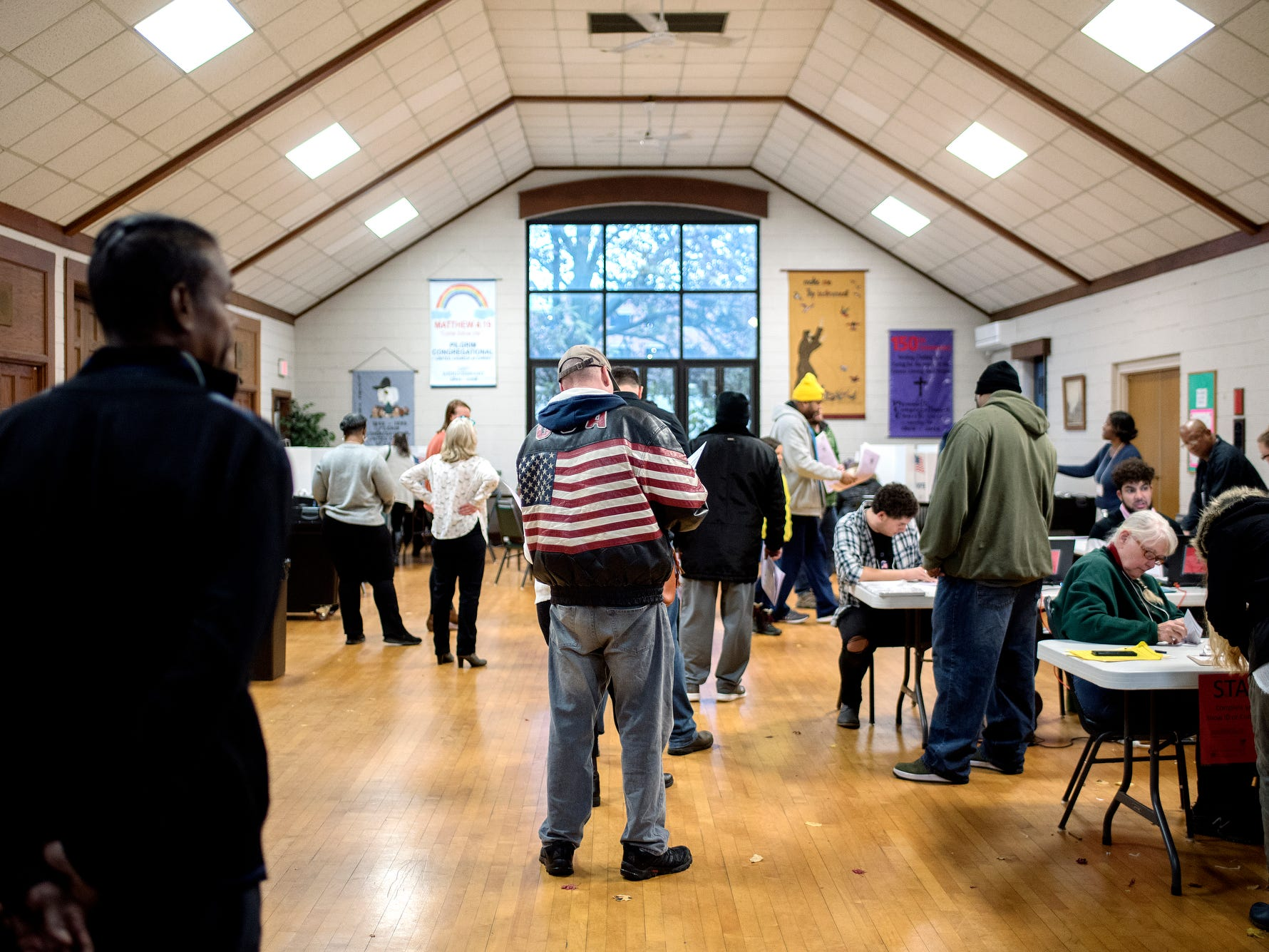 People vote at the polling place inside the Pilgrim Congregational United Church of Christ on Tuesday, Nov. 6, 2018, in Lansing.