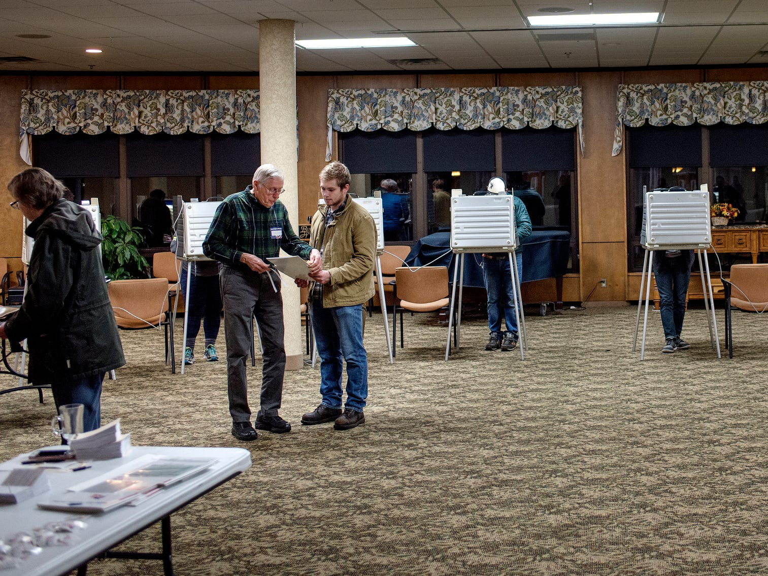 People vote on Tuesday, Nov. 6, 2018, at the polling place inside Burcham Hills retirement community in East Lansing.