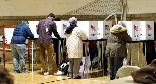 Voters in Ward 1 Precinct 5 cast their votes at Foster Community Center Tuesday, Nov. 6, 2018. At 4:30 606 people had cast their ballots.