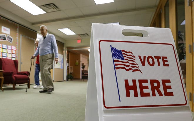 FILE - Voters enter the 8th District polling place at Redeemer Lutheran Church to cast their ballots Tuesday, Nov. 6, 2018, in Manitowoc.
