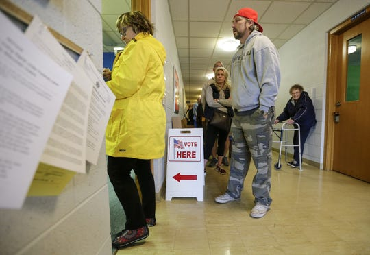 A line of voters stretches down the hall of Lakeshore United Methodist Church Tuesday, November 6, 2018, in Manitowoc, Wis. Joshua Clark/USA TODAY NETWORK-Wisconsin