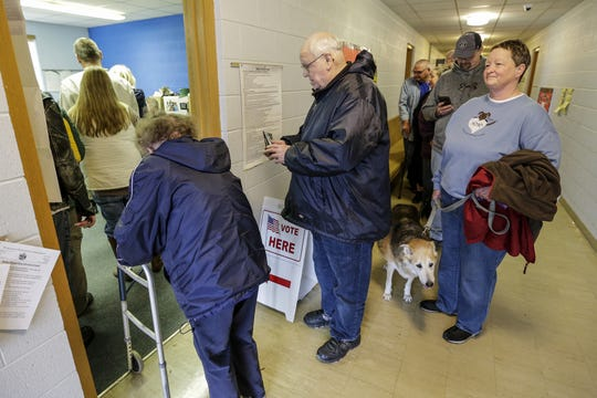 A line of voters stretches down the hall of Lakeshore United Methodist Church on Election Day Tuesday, November 6, 2018, in Manitowoc, Wis. Joshua Clark/USA TODAY NETWORK-Wisconsin