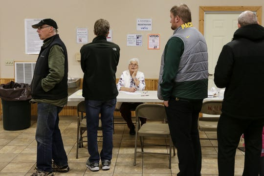 Poll worker Phyllis Elfner talks to voters waiting in line at the 6th District polling place in Lincoln Park Tuesday, November 6, 2018, in Manitowoc, Wis. Joshua Clark/USA TODAY NETWORK-Wisconsin
