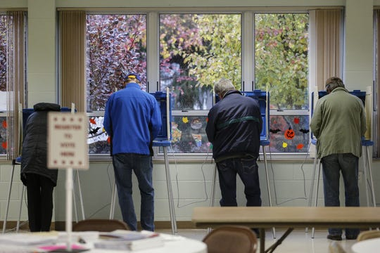 People vote on a wet and dreary day in the 10th District at the First Reformed United Church of Christ Tuesday, November 6, 2018, in Manitowoc, Wis. Joshua Clark/USA TODAY NETWORK-Wisconsin