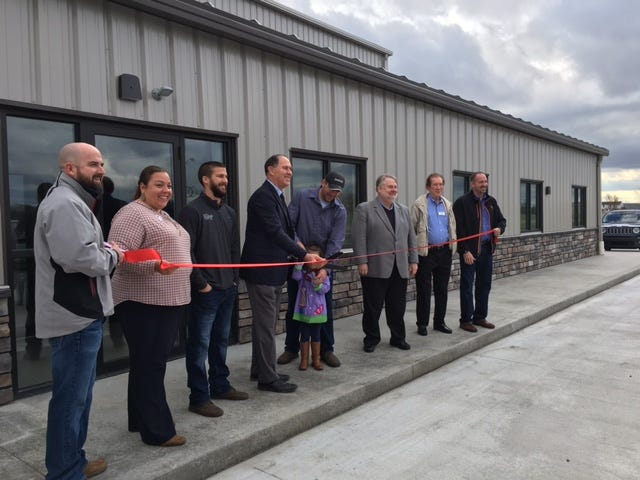 Lloyd Rebar Co. celebrated its new expansion and facility Tuesday at 139 Technology Parkway in Shelby. Jared Mawhorr, standing to the right of Shelby Mayor Steve Schag, is the owner. Mawhorr's daughter helped cut the ribbon.