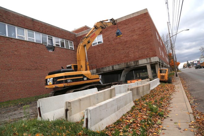 Heavy machinery sits in the front portion of the former YMCA on Park Avenue West in Mansfield on Tuesday.