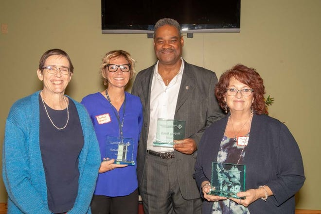 The Helping Hands Award winners, from left, areSarita Lawrence, Courtnie Howell, Benjamin McDay, and Cindy Ison.