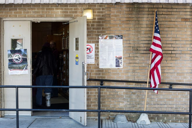November 06 2018 - A voter walks into the voting location inside of the Lewis Senior Center.