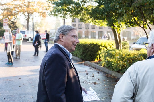 Germantown mayoral candidate John Barzizza speaks with a voter outside of a voting location at Riveroaks Reformed Presbyterian church in Germantown on Election Day.