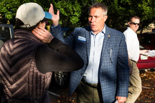 Germantown Mayor Mike Palazzolo speaks with a voter outside of a voting location at Riveroaks Reformed Presbyterian church in Germantown on Election Day.