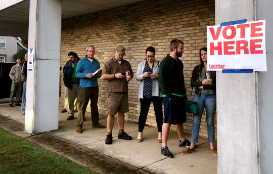 Voters line up at Central Christian Church on South McLean just after 6 a.m.
