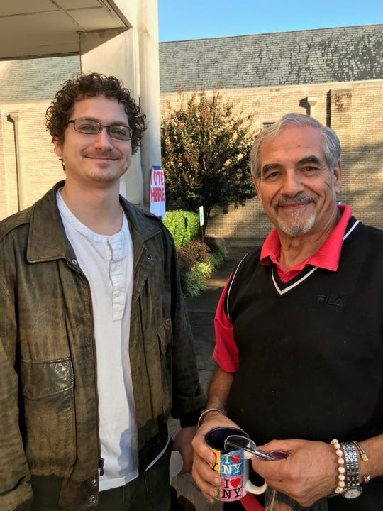 Walid Sakaan, right, and his son, Zach Sakaan arrived early to vote at Christ City Church in Memphis.