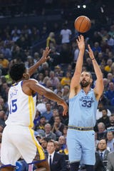 Memphis Grizzlies center Marc Gasol (33) shoots the basketball against Golden State Warriors center Damian Jones (15) during the first quarter at Oracle Arena.