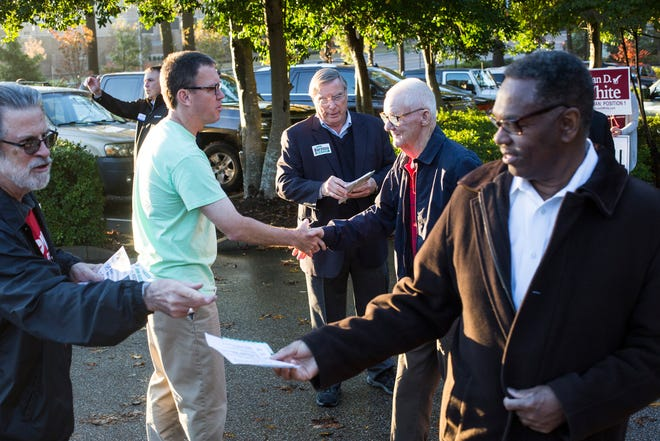 People campaign outside of a voting location at Riveroaks Reformed Presbyterian church in Germantown on Election Day.