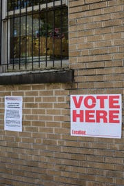 November 06 2018 - Signs are seen outside of a voting location inside of the Lewis Senior Center.