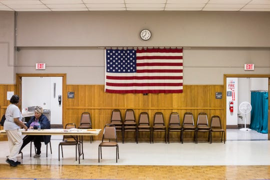 A voter moves through the voting location inside of the Lewis Senior Center on Nov. 6, 2018.